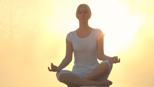 HD DOLLY: Meditating In Nature At Sunrise