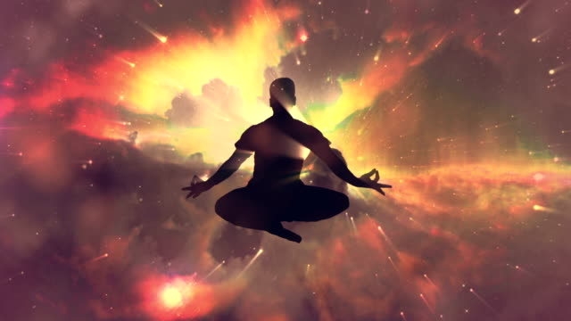 meditating man enlightenment or meditation and universe - lotus position stock videos and b-roll footage