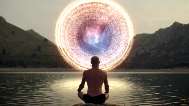 meditating man opening gate to cosmic energy - buddhism stock videos & royalty-free footage