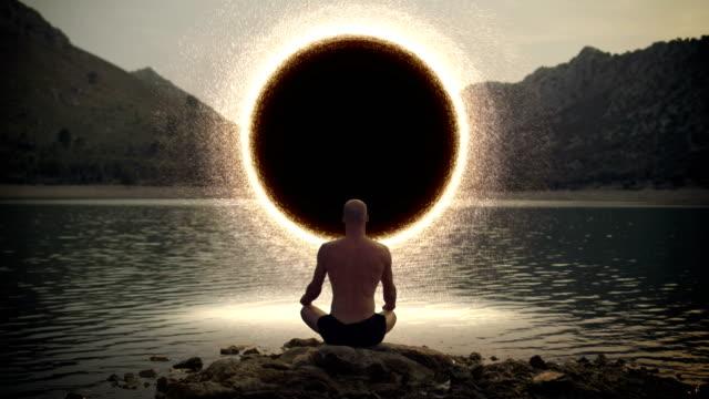 meditating man opening gate to cosmic energy - allerta video stock e b–roll
