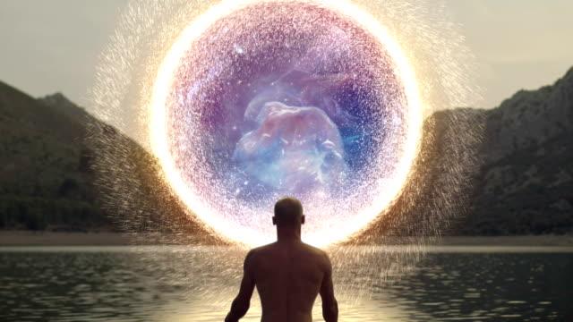 meditating man opening portal to cosmic energy. horshead nebula - atmosphere filter stock videos & royalty-free footage