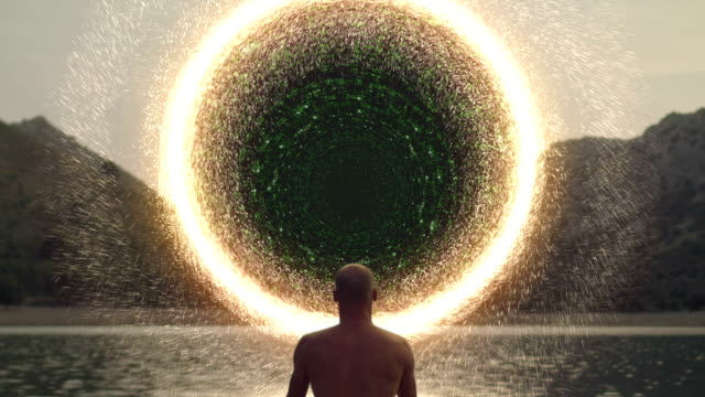 meditating man opening portal with digital energy - parallelo video stock e b–roll