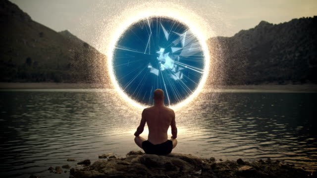 meditating man opens portal with digital energy - paranormale video stock e b–roll