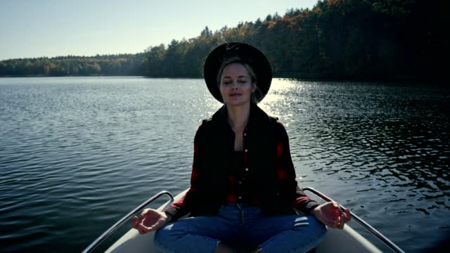meditating on a kayak. sunny autumn day - buddhism stock videos & royalty-free footage