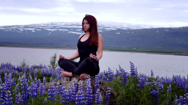 Meditating on a meadow full of blooming lupines