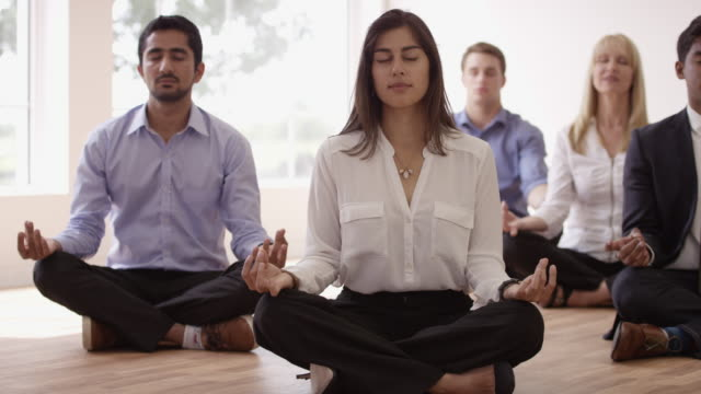 meditation in the workplace - wellbeing stock videos & royalty-free footage