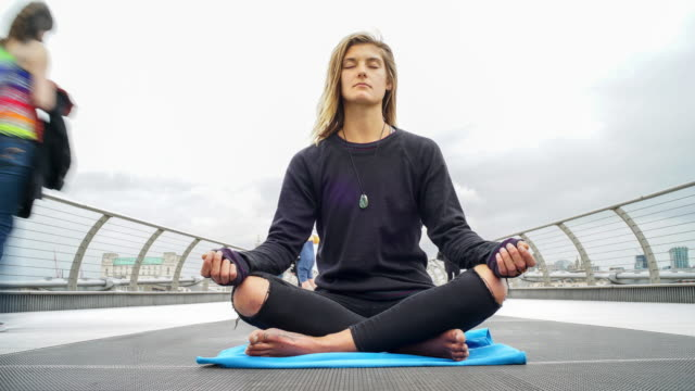 meditation mindfulness time-lapse - person cross legged stock videos & royalty-free footage