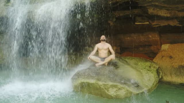 meditation under waterfall - zen like stock videos & royalty-free footage