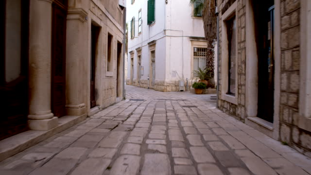 pov mediterranean alley with cobbled street - old town stock videos & royalty-free footage