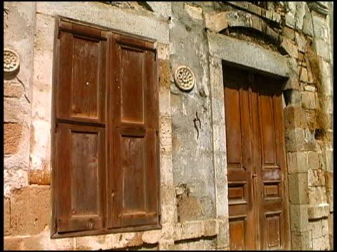 mediterranean ancient door and window - wood material stock videos & royalty-free footage