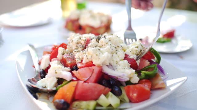 mediterranean food, greek salad in the sun - feta stock videos & royalty-free footage