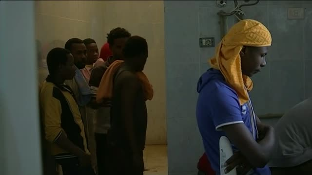 misrata detention centre libya misrata ext various shots migrants seen through bars or grating at misrata detention centre various shots migrants at... - deformed stock videos & royalty-free footage