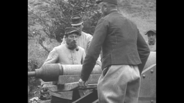 vs medium and cu french soldiers load position and fire world war i french mortar gun one soldier smokes pipe and another smokes cigarette / note... - french army stock videos & royalty-free footage