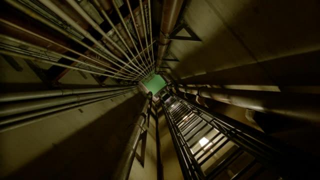 medium angle moving pov of elevator shaft.