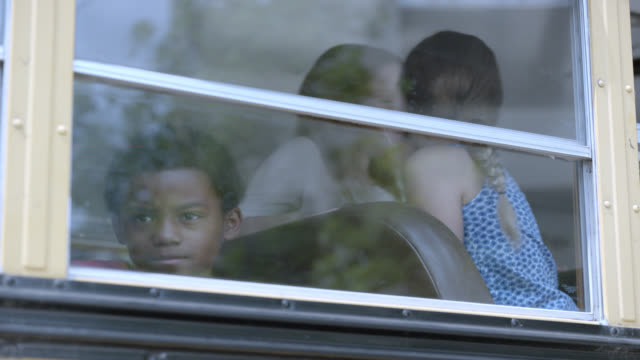 medium angle of children on school bus screaming. bus shakes. could be accident, disaster, or attack. - girls wearing see through clothes stock videos and b-roll footage