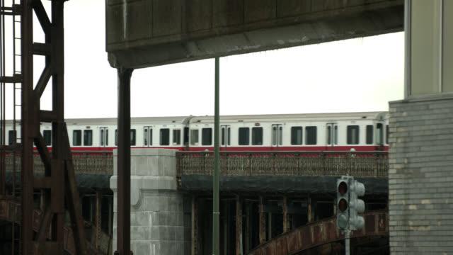 medium angle of metro train on elevated tracks. longfellow bridge.