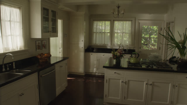 medium angle of middle class kitchen. - middle class stock videos and b-roll footage