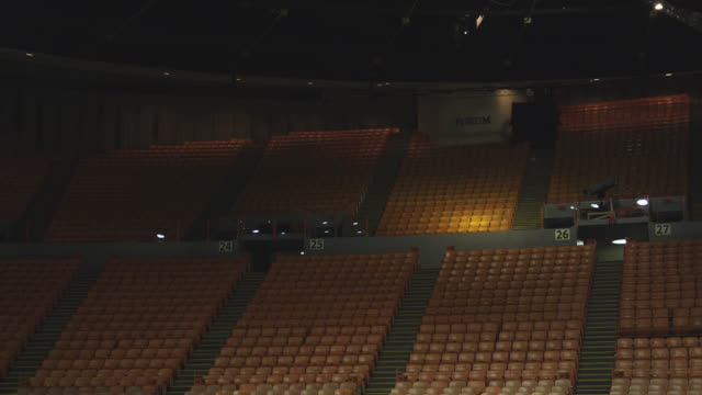 medium angle of stadium, auditorium, or concert venue. empty seats visible. the forum. - stabilimento sportivo video stock e b–roll