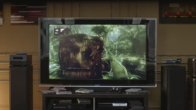 Medium angle of television screen with video game burn-in. sound speakers visible net to tv consol. could be living room.