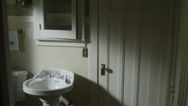 medium angle walking pov of bathroom, sink, iphone or cell phone, and open window. as if someone climbed or escaped out the window. - bathroom stock videos and b-roll footage