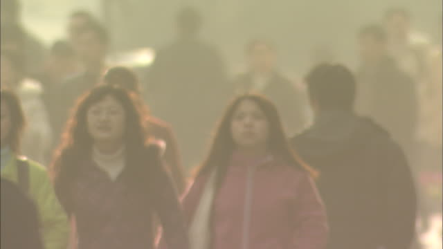 medium close shot of people in the street - smog video stock e b–roll