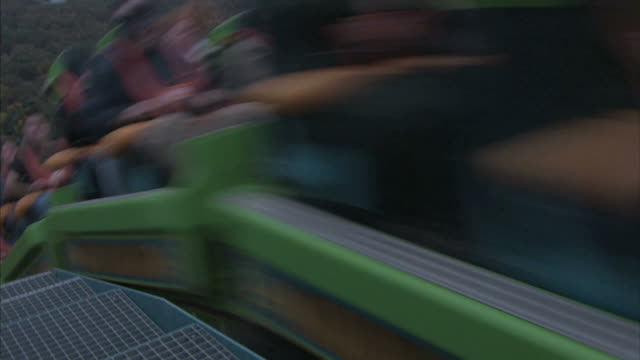 medium close up hand-held - the kingda ka roller coaster races over a track overlooking a city near a river / six flags great adventure jackson, nj - jackson new jersey stock videos and b-roll footage
