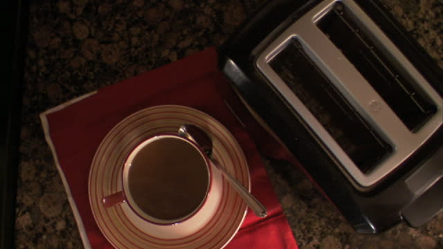 medium close up pan,right , a woman makes toast for breakfast. /  - toasted bread stock videos and b-roll footage