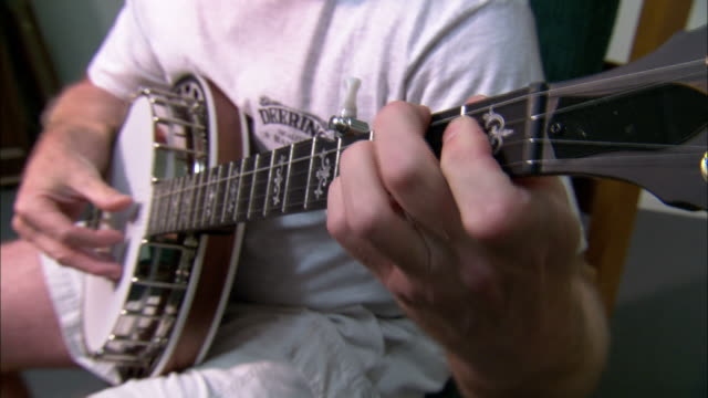 medium close up static - a musician plays a banjo /  california, united states - banjo stock videos & royalty-free footage