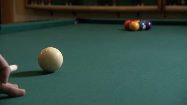 medium close up static - a pool cue strikes the cue ball,  knocking it into the racked billiard balls /  wisconsin, united states - pool cue sport stock videos & royalty-free footage