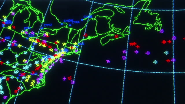 Medium Close Up static - An FAA radar screen displays the locations of aircraft arriving at and departing from airports in New York.