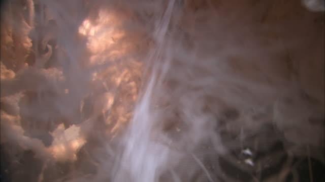 medium close up static - fiberglass tumbles in a fiberizer /  kansas, united states - fibreglass stock videos and b-roll footage