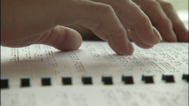 medium close up static - fingers touch braille on the page of a book. - blindness stock videos & royalty-free footage