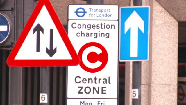 medium close up static - road signs indicate a congestion charging zone in london. / london, england - sign stock videos & royalty-free footage