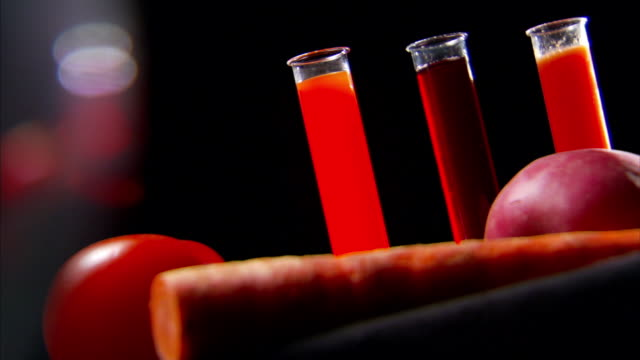 vidéos et rushes de medium close up static - test tubes contain fruit and vegetable juices.   - boisson rafraîchissante