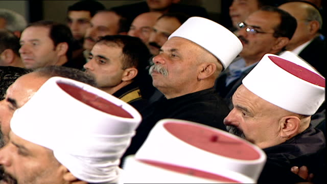 medium close-up of druze sheikhs at a community meeting. the turban and dress of the sheikhs indicates they are uqqal, initiated druze. - turban stock videos & royalty-free footage