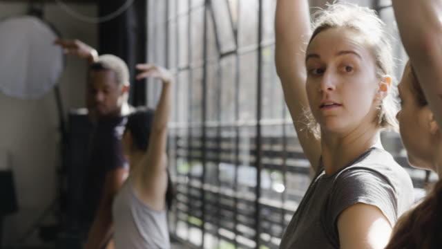 vidéos et rushes de medium close-up shot of two female dancers rehearsing in dance studio - sport d'équipe