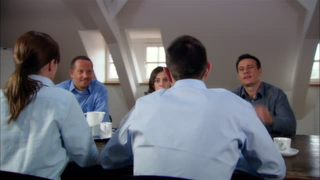 medium dolly shot five people at business meeting/ munich, germany - bricco video stock e b–roll