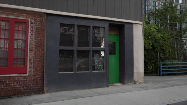 stockvideo's en b-roll-footage met medium exterior of a bar in the day - bar gebouw