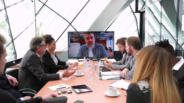 medium group of businesspeople having a conference call in the office - video conference stock videos & royalty-free footage