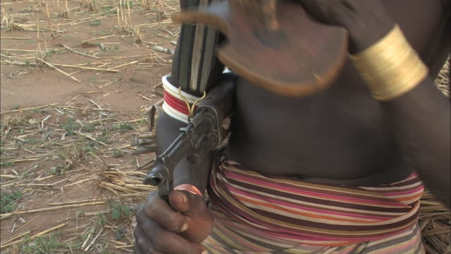 medium hand-held - an ethiopian man holds a rifle. / ethiopia - ethiopia stock videos & royalty-free footage