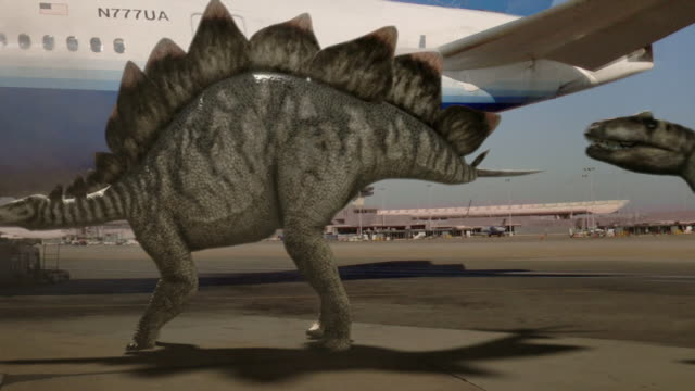 vídeos de stock, filmes e b-roll de medium hand-held pan-left pan-right - a stegosaurus defends itself from a tyrannosaurus rex near a passenger jet in a computer-generated animation. / washington, dc, usa - jurássico