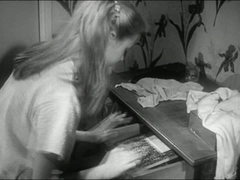 1954 medium high angle shot blonde teenage girl going through messy chest of drawers in search of something  / audio - open drawer stock videos & royalty-free footage