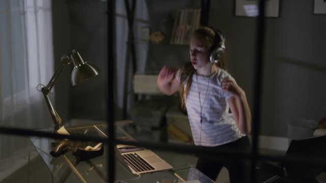 medium high angle view of girl dancing to music on laptop / cedar hills, utah, united states - legging stock-videos und b-roll-filmmaterial
