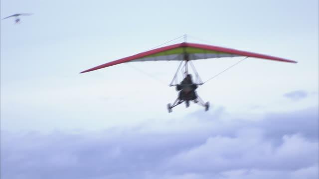 """medium long shot hand-held pan-right zoom-out-an ultralight comes in for a landing on a runway. / kenai peninsula, alaska, usa"" - kenai peninsula stock videos & royalty-free footage"