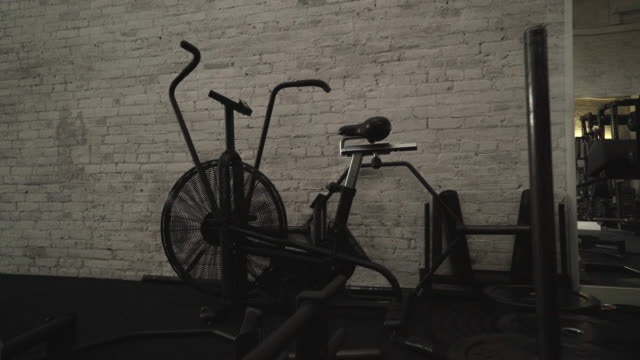 medium long shot of excercise bike - cardiovascular exercise stock videos & royalty-free footage