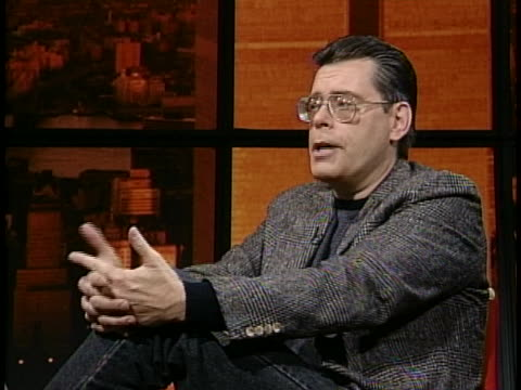 medium long shot of stephen king in studio giving an interview. he is wearing blazer and glasses. stephen king says when iêpublishedêmy second... - science fiction film stock videos & royalty-free footage