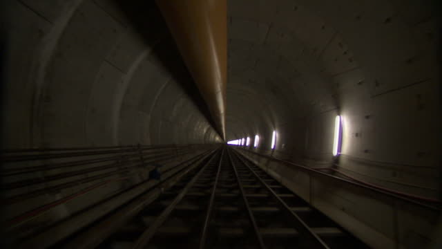 Medium Long Shot push-in - A large pipe and lights line the Bering Strait Tunnel. / Istanbul, Turkey
