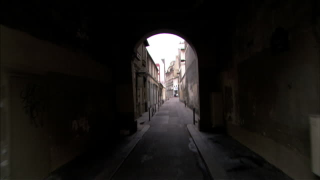 medium long shot push-in - a cgi transforms a narrow alleyway in paris today back to what it may have looked like in ancient times. / paris, france - narrow stock videos & royalty-free footage