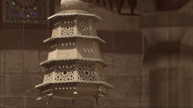 medium long shot, static - an ornate lantern hangs in a mosque / egypt - lantern stock videos & royalty-free footage