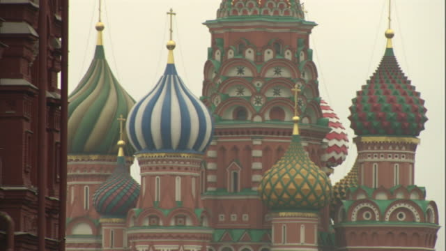 medium long shot static - gold crosses top the onion domes of st. basil's cathedral. / moscow, russian federation - st. basil's cathedral stock videos and b-roll footage